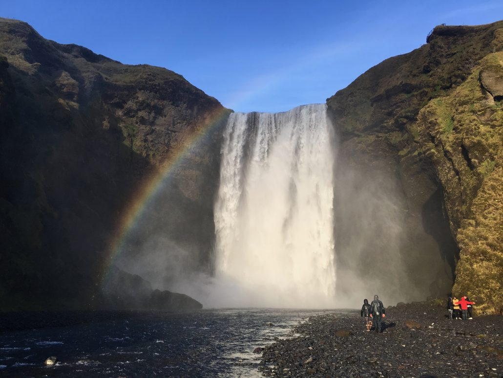 Image of a rainbow over a waterfall