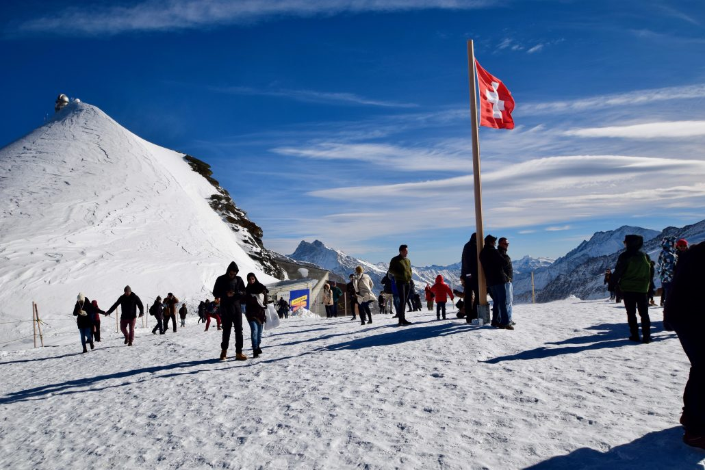 Tourists enjoying stunning views of the Alps at Junfrau, Switzerland.