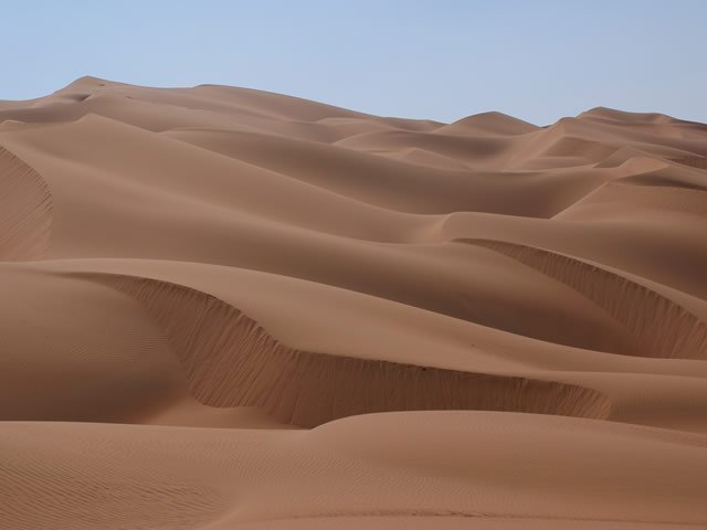 an image of sand dunes in a desert