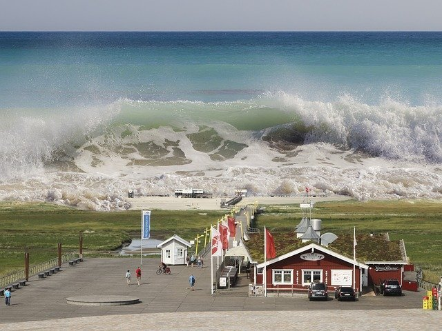 an image of a tsunami approaching the coast