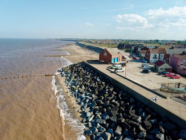 Sea wall, rock armour and groynes at Withernsea - view south