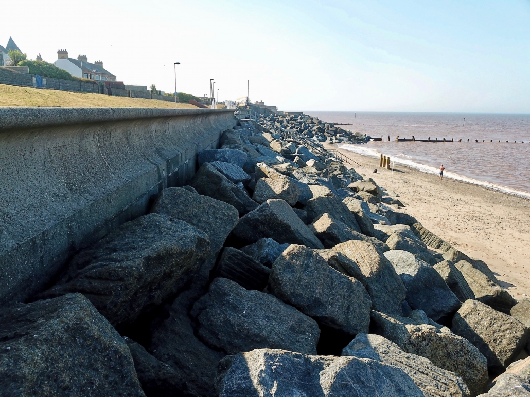 Recurved sea wall, rock armour and groynes at Withernsea
