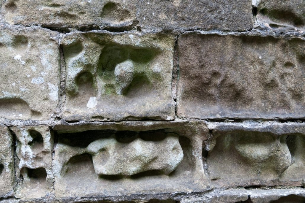 Limestone bricks weathered by acidic rain
