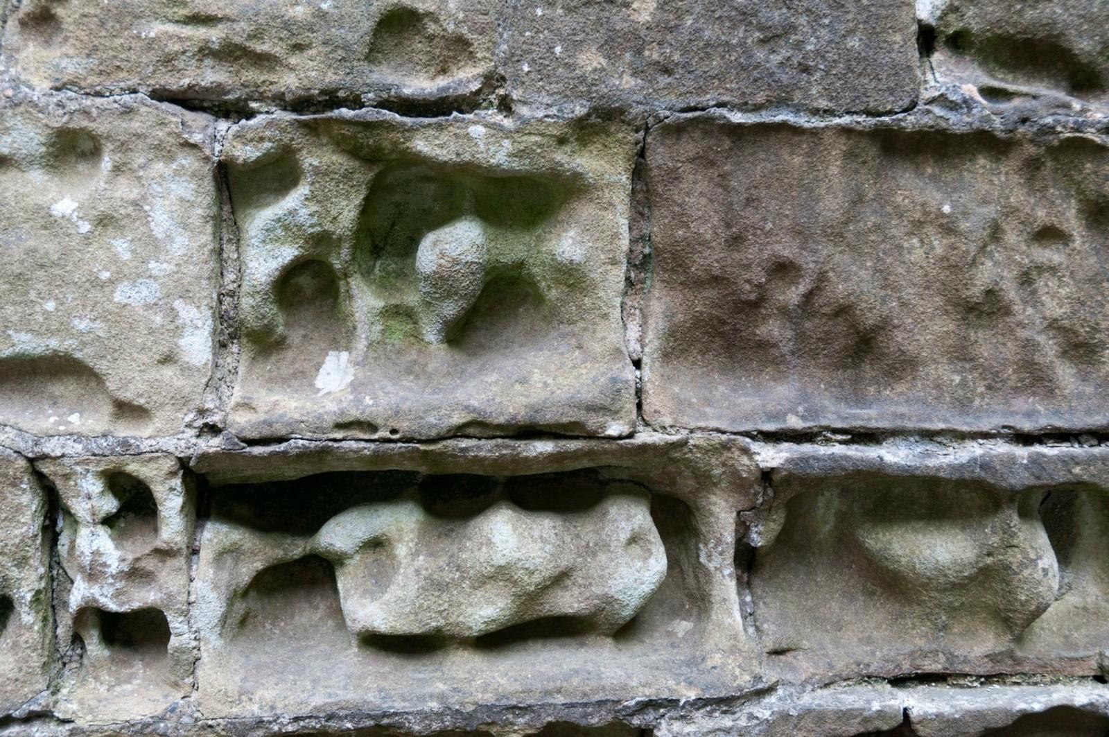 Limestone bricks weathered by acidic rain