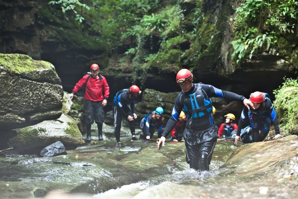 Group gorge walking at How Stean Gorge