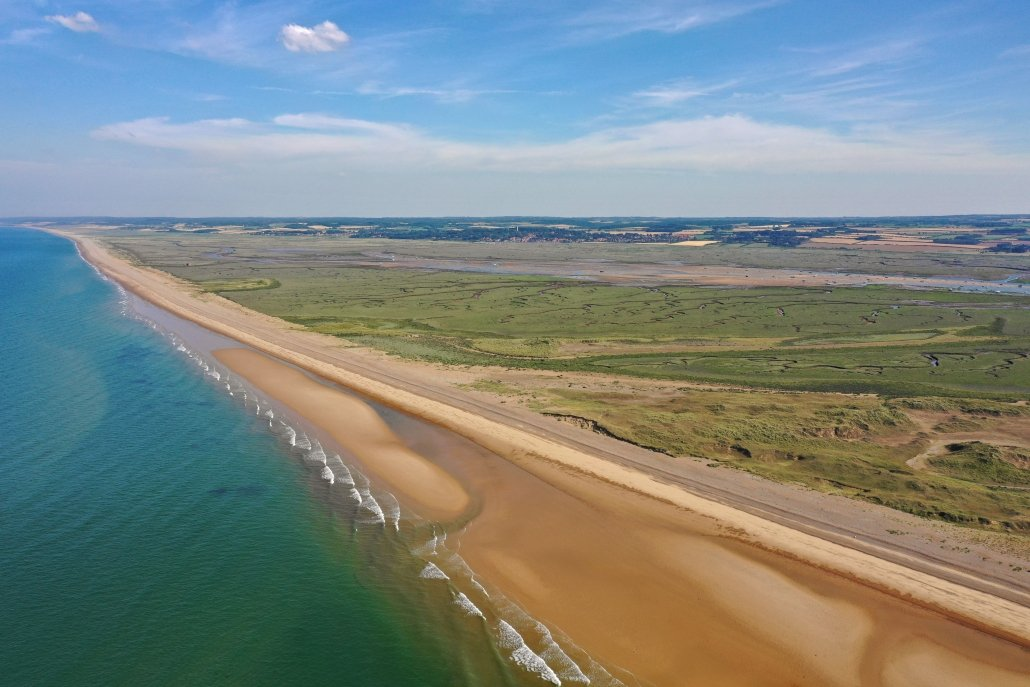 Sediment becomes smaller and sand dunes form as you travel north-west along the spit