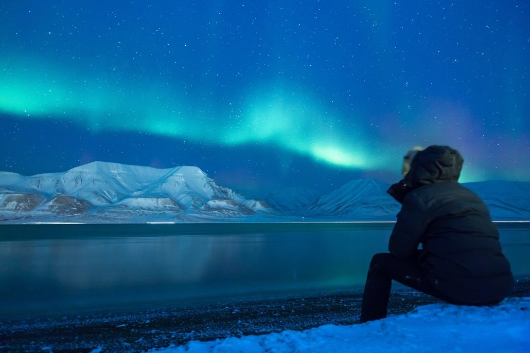 An image of a man looking at the northern lights