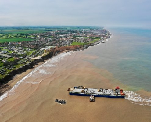 Aerial view of Withernsea and unloading rock armour
