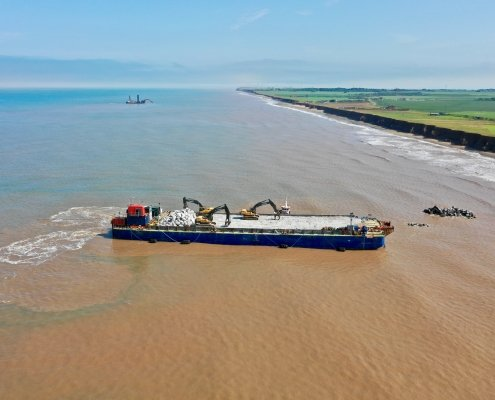 Barge and support craft at Withernsea