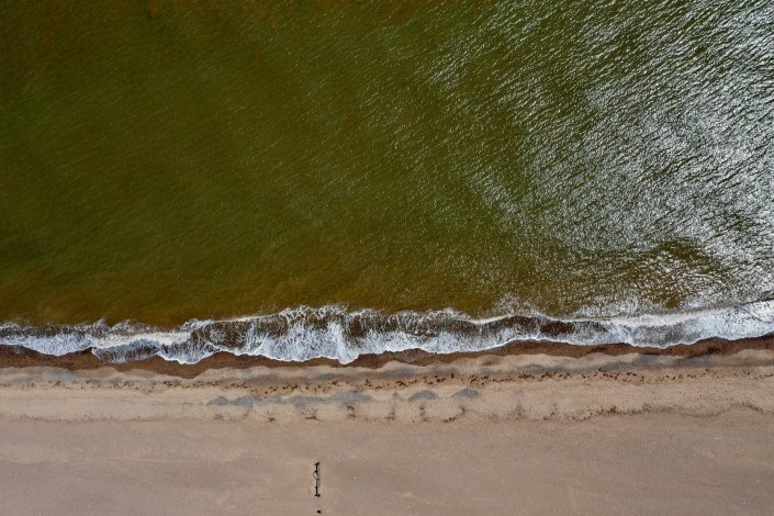 Aerial view of waves approaching Spurn Point